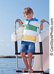 Boy on a catamaran in the Mediterranean