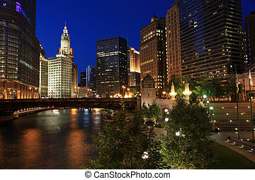 Chicago River at Night with colorful lights of the city...