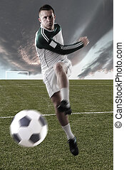 football player on field playing with a ball