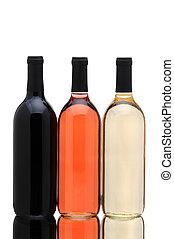 Wine bottles on white