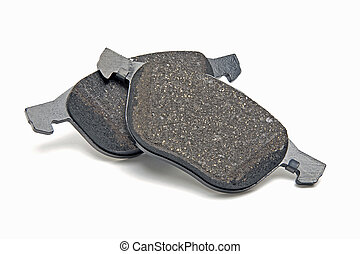 automobile brake pads on a white background