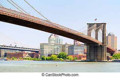 Brooklyn Bridge spanning the East River towards Brooklyn in...