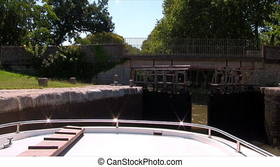 boat passes through the floodgate