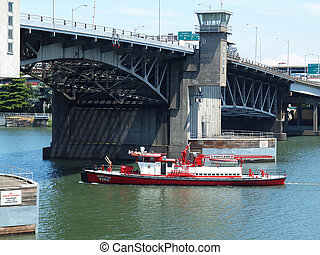 The Morrison bridge and fire boat P - A fire-boat passing...