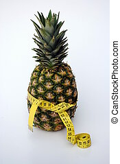 ananas with a tape measure, concept of diet