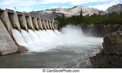Hydro electric power dam with spillway