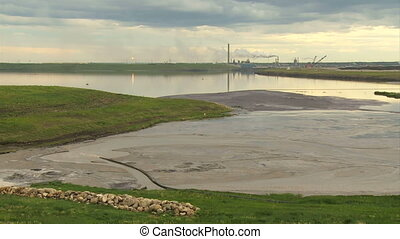 Oil sands plant and tailings pond