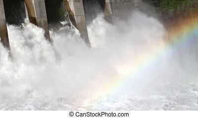 Hydro electric power dam with spillway and rainbow