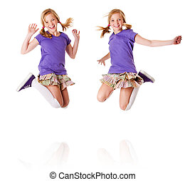 Happy identical twins jumping and laughing - Happy teenager...