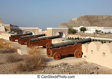 Cannons at the fortified gate to Muttrah, Muscat, Sultanate...