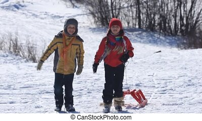 Friends - A boy and a girl walking together and then riding...
