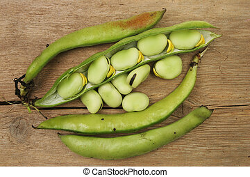 Beans on wood - Freshly picked homegrown broad beans on old...