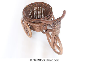 Tricycle - Wooden tricycle with a basket on a white...