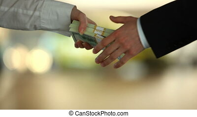 Buying a car - Female hand giving dollar bill to male and...