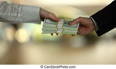 Sell - Female hand taking dollar bill from male and giving...