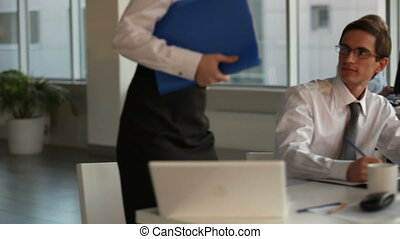 Consultancy - Pretty secretary coming up to businessman,...
