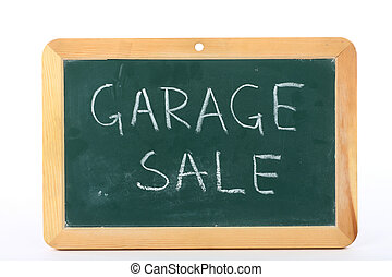 garage sale text written on blackboard