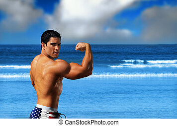 Bodybuilder on the beach - Young muscular sexy male body...