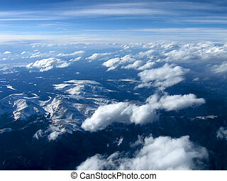 azure blue sky with clouds over mountain landscape