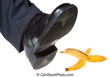 step on a banana peel on white background
