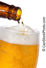 beer - Beer is pouring into glass on white background