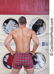 Muscular Man In Laundromat - Muscular man in boxer shorts...
