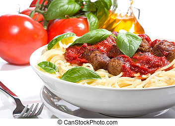pasta with meatballs and basil with tomato sauce.