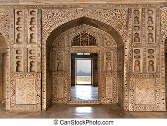Decorated marble wall frames gate and door at Agra Fort...