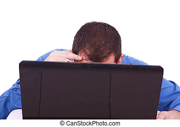 A bald man hiding behind his laptop computer screen.