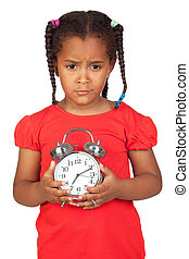 Sad little girl with a silvered clock isolated on a over...