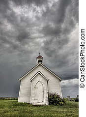 Old Country Church in Saskatchewan Canada with storm clouds