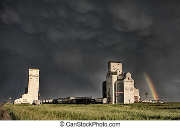 Prairie Grain Elevator in Saskatchewan Canada with storm...