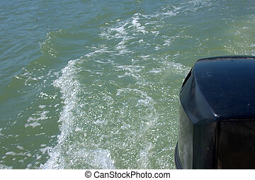 wake behind motor boat - Looking back as motor churns the...
