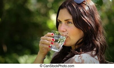 Cold glass of water - Drinking a glass of cold fresh water