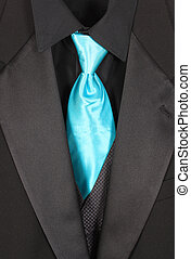 Closeup of three piece suit with blue tie - Black dressy...