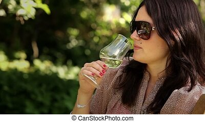 Tasting wine - Drinking wine in garden