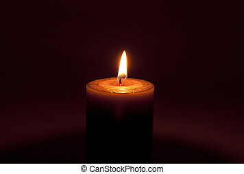 candle in the darkness, on a brown background