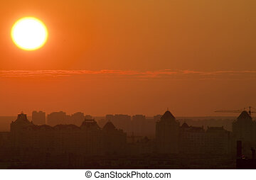 Early morning. Sunrise over the city sonce