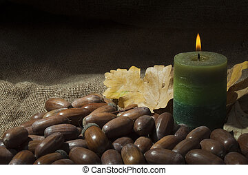 Beautiful background with acorns and a candle