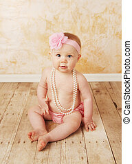 Baby girl wearing pearls