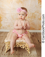 Sweet little baby girl - Adorable young baby girl wearing a...