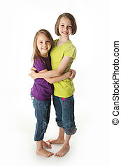 Sweet sisters - Cute young sisters isolated on white in...