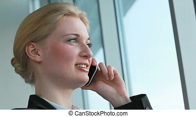 Mobile communication - Pretty woman speaking on cellular...