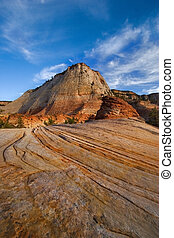 Striped life - Red and orange hill on a uneven striped soil...