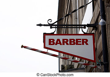 barber shop sign hanging on a bracket