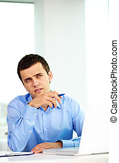 Employer - Portrait of pensive businessman looking aside...