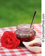 Jar of the rose jam - Jar of rose jam and one rose on the...