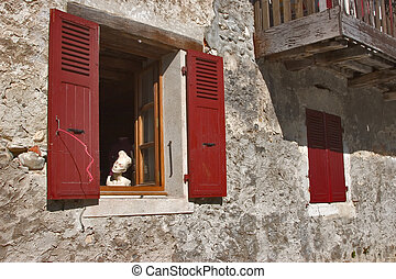 Dummy in a red window. - A head of a doll of a dummy in a...