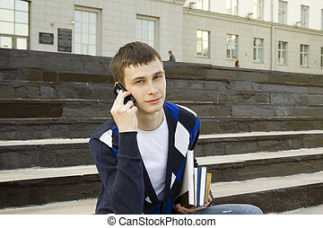 Modern studen - Close-up of a modern student talking on a...