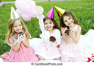 Birthday party - Three young girls outdoors merry, celebrate...
